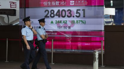 Asian shares rise as investors await Japan vote, Fed choice