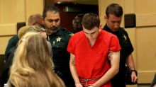 Head bowed, Florida shooting suspect returns to court for hearing