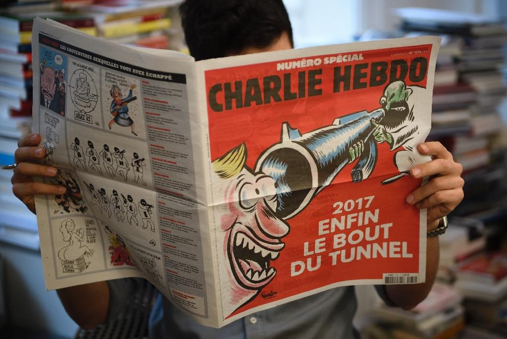 Charlie Hebdo marked the second anniversary of the terror attack on its staff with a front-cover cartoon showing a laughing man staring down the barrel of a jihadist's rifle (AFP Photo/Eric Feferberg)