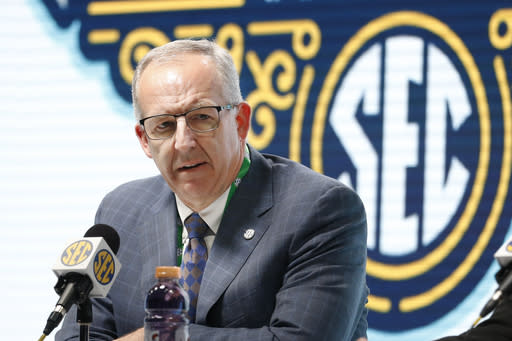 FILE - In this March 11, 2020, file photo, Southeastern Conference Commissioner Greg Sankey announces that fans will not be allowed in the arena to watch NCAA college basketball games in the SEC tournament in Nashville, Tenn. After the Power Five conference commissioners met Sunday, Aug. 9, 2020, to discuss mounting concern about whether a college football season can be played in a pandemic, players took to social media to urge leaders to let them play. (AP Photo/Mark Humphrey, File)