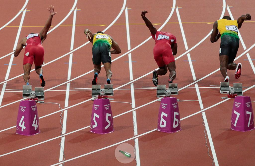A bottle is thrown onto the track at the start of the Men's 100m Final on Day 9 of the London 2012 Olympic Games at the Olympic Stadium on August 5, 2012 in London, England. (Photo by Adam Pretty/Getty Images)
