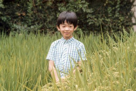 Japan's Prince Hisahito, the only son of Prince Akishino and Princess Kiko, poses at a rice field of the Akasaka Detached Palace in Tokyo