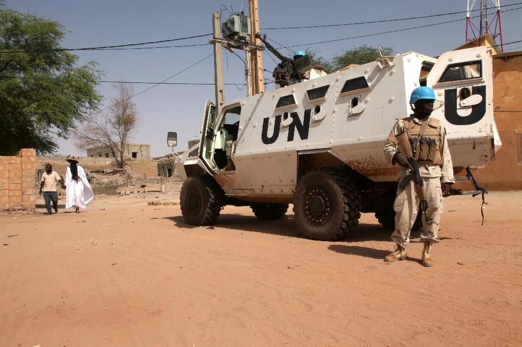 The UN mission, which counts almost 11,000 peacekeepers, has been deployed in Mali since 2013 to counter a jihadist insurgency and general lawlessness (AFP Photo/SEBASTIEN RIEUSSEC)