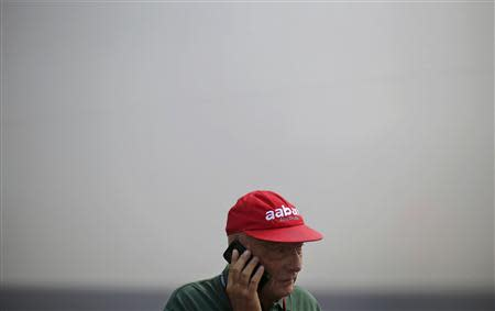 Former Formula One champion Lauda talks on his phone during the third practice session of the Italian F1 Grand Prix at the Monza circuit