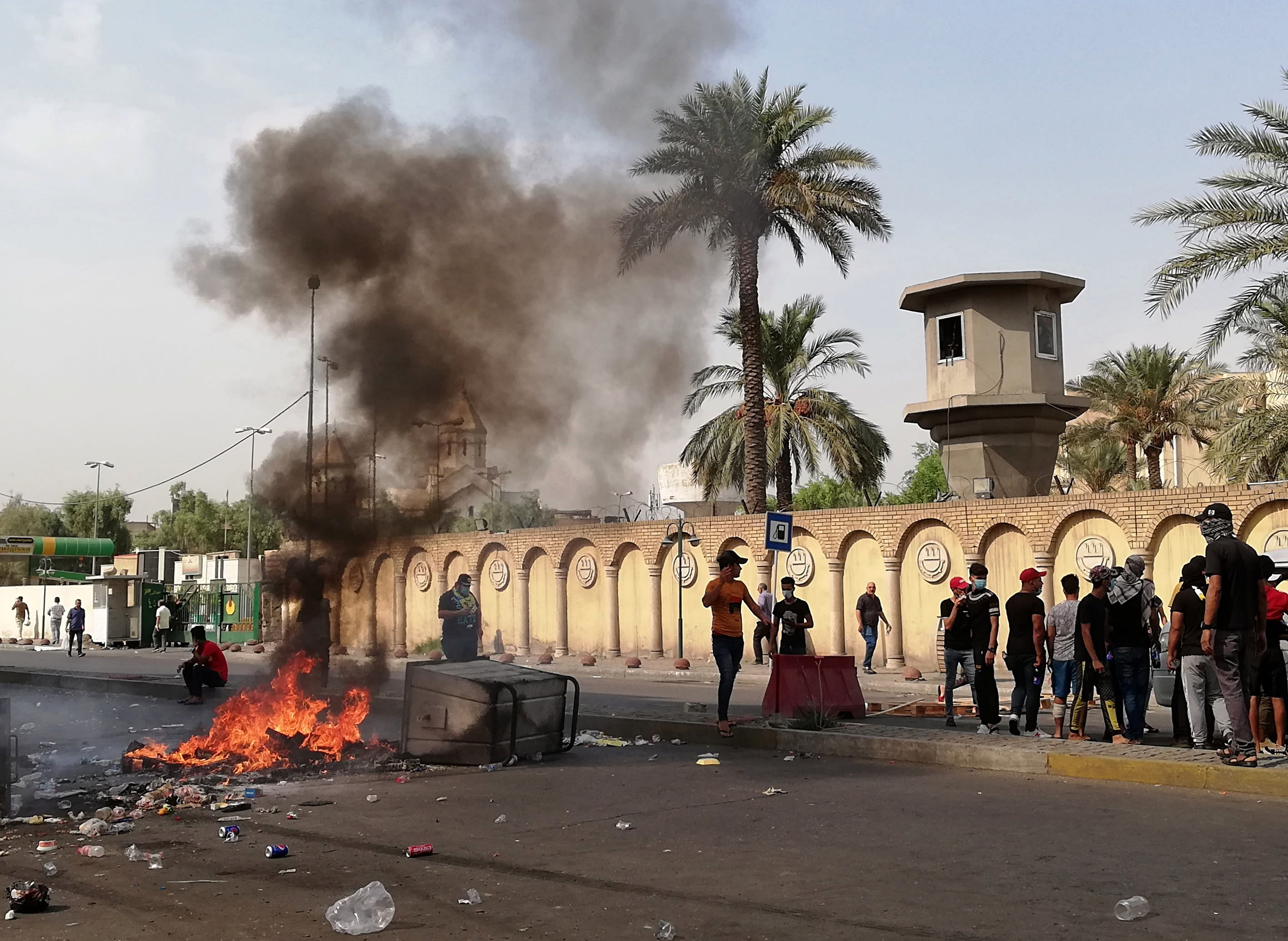 Anti-government protesters set a fire and block roads in front of the Ministry of Higher Education and Scientific Research in Baghdad, Iraq, Wednesday, Oct. 2, 2019. Security forces fired in the air and used tear gas Wednesday to disperse groups of demonstrators in Baghdad Wednesday, killing at least one and injuring six in renewed protests after violent confrontations between protesters and police a day earlier, officials said. (AP Photo/Hadi Mizban)