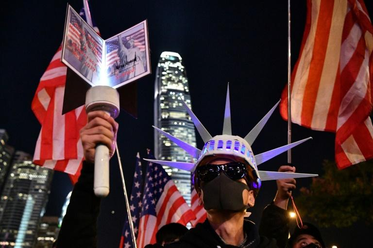 Hong Kong pro-democracy demonstrators had an outburst of pro-US sentiment when President Donald Trump signed the Hong Kong Human Rights and Democracy Act (AFP Photo/Anthony WALLACE)