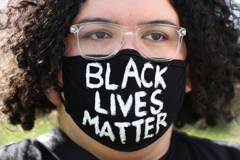 People demonstrate in solidarity with the Black Lives Matter (BLM) rallies in the United States, calling for an end to police brutality against Black people in the United States and First Nations people in Australia, in Sydney