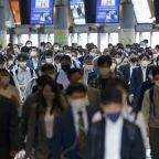 Packed trains, drinking: Japanese impatient over virus steps