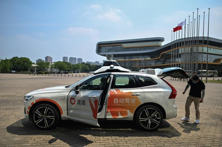Chinese consumers -- known for eagerly embracing e-commerce, online payments and other digital solutions -- are lining up for a spin in DiDi Chuxing's self-developed autonomous taxis at a Shanghai pilot project launched in June