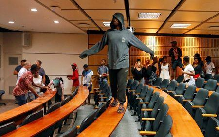 Demonstrating students disrupt lectures during protests demanding free tertiary education at the University of Cape Town (UCT) in Cape Town, South Africa. REUTERS/Mike Hutchings