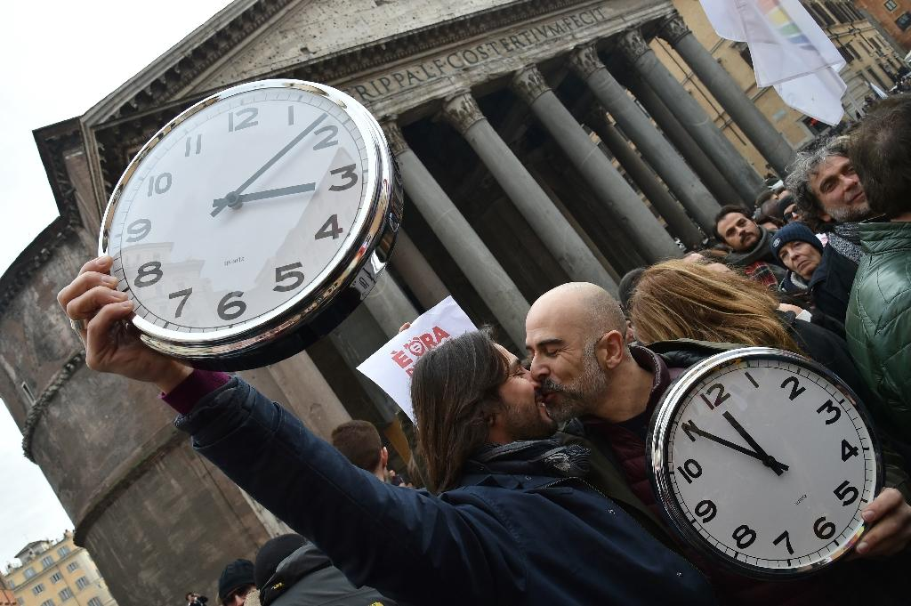 """In January supporters of same-sex marriage held alarm clocks at a demonstration in Rome """"to wake up Italy"""" on gay couples having their relationships legally recognised and protected (AFP Photo/Alberto Pizzoli )"""