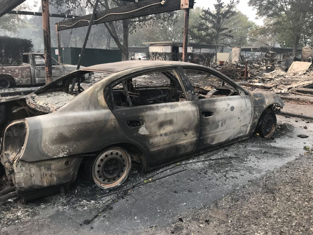 The remains of a car found in a destroyed Santa Rosa neighborhood