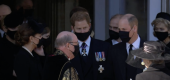 Prince Harry, center, Prince William, right, and Kate Middleton, left, were spotted talking after the service. (BBC)