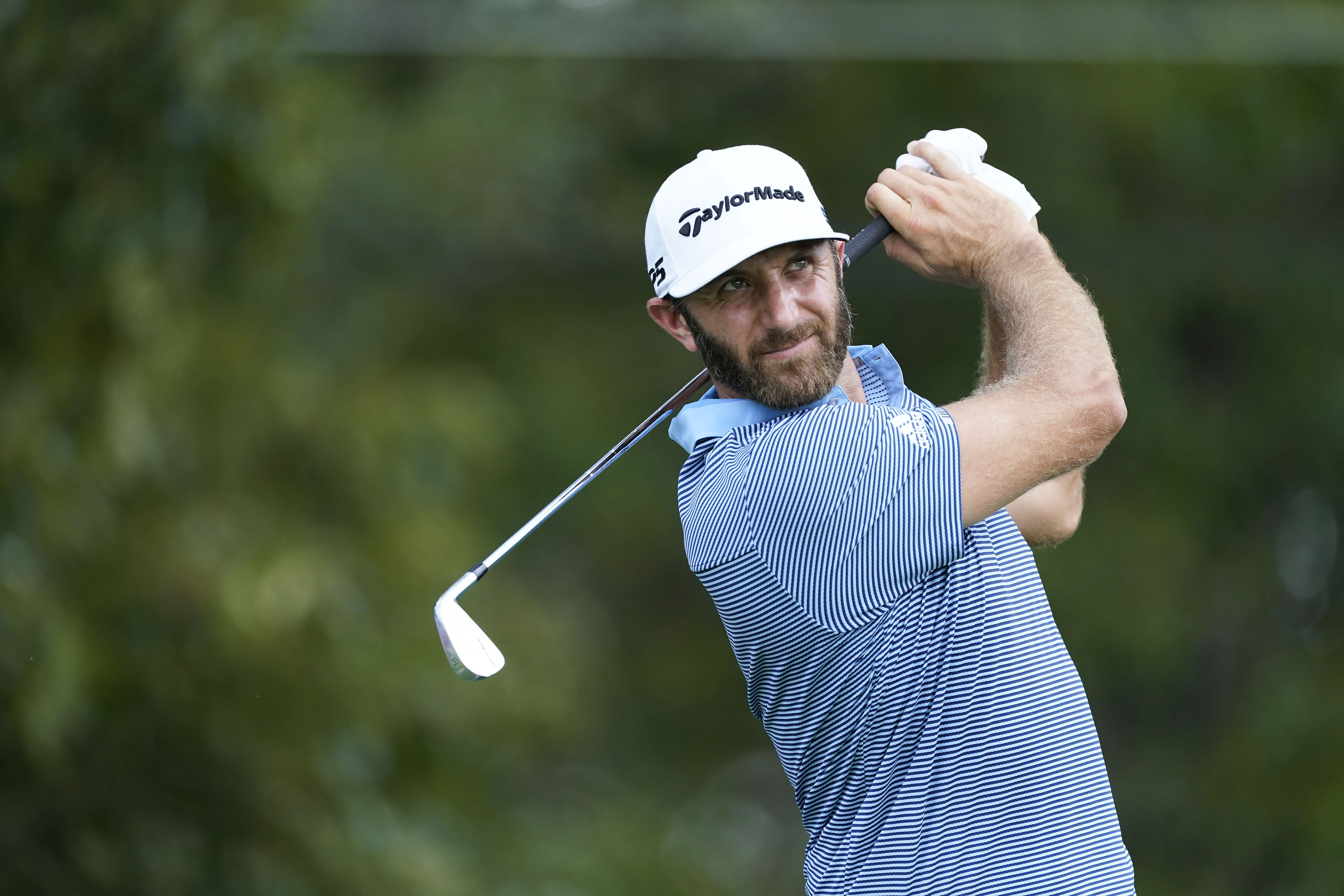 Dustin Johnson hits on the third tee during the first round of the Tour Championship golf tournament at East Lake Golf Club in Atlanta, Friday, Sept. 4, 2020. (AP Photo/John Bazemore)