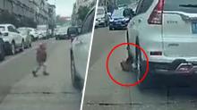 Boy miraculously unharmed after car runs him over