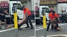 Two men trade blows in middle of busy street during road rage brawl