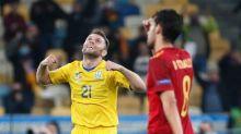 Ukraine stun Spain in noisy stadium