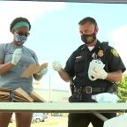 Norwood neighbor teams up with police department to hand out face masks