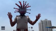 Police Inspector in India Patrols the Streets in Coronavirus-Themed Helmet
