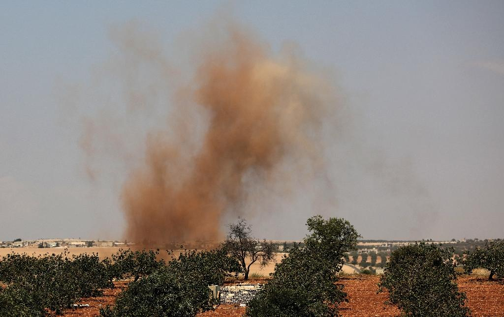 This picture taken on September 6, 2018 shows smoke plumes rising from Syrian regime bombardment on the town of Al-Tamanah on the southern edges of the rebel-held Idlib province