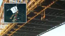Six protesters abseil off Sydney Harbour Bridge