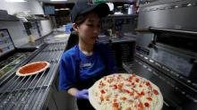 Domino's Pizza same-store sales miss estimates, sending shares lower