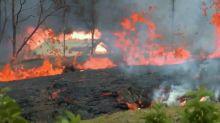 Lava from Hawaii's Kilauea volcano flows toward the coast, destroys homes in its path
