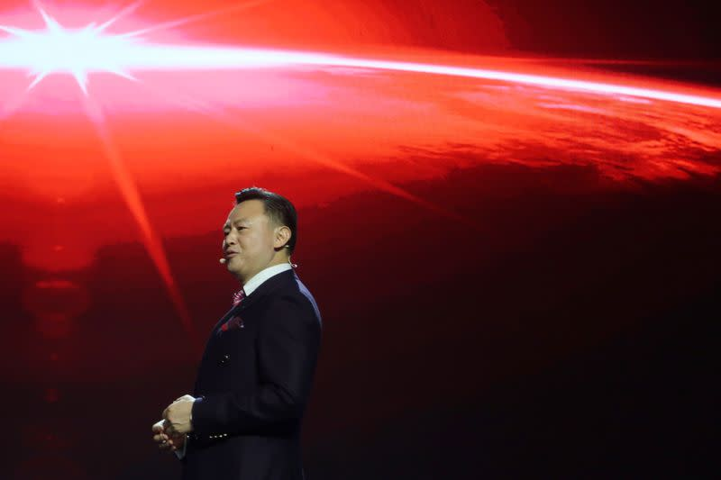 Xu Liuping, chairman of China's FAW Group, speaks at an event of Chinese car marque Hongqi, or Red Flag, held at the Great Hall of the People in Beijing