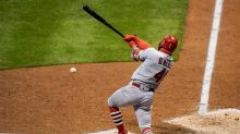 Cards, Brewers split pair as both games go extra innings