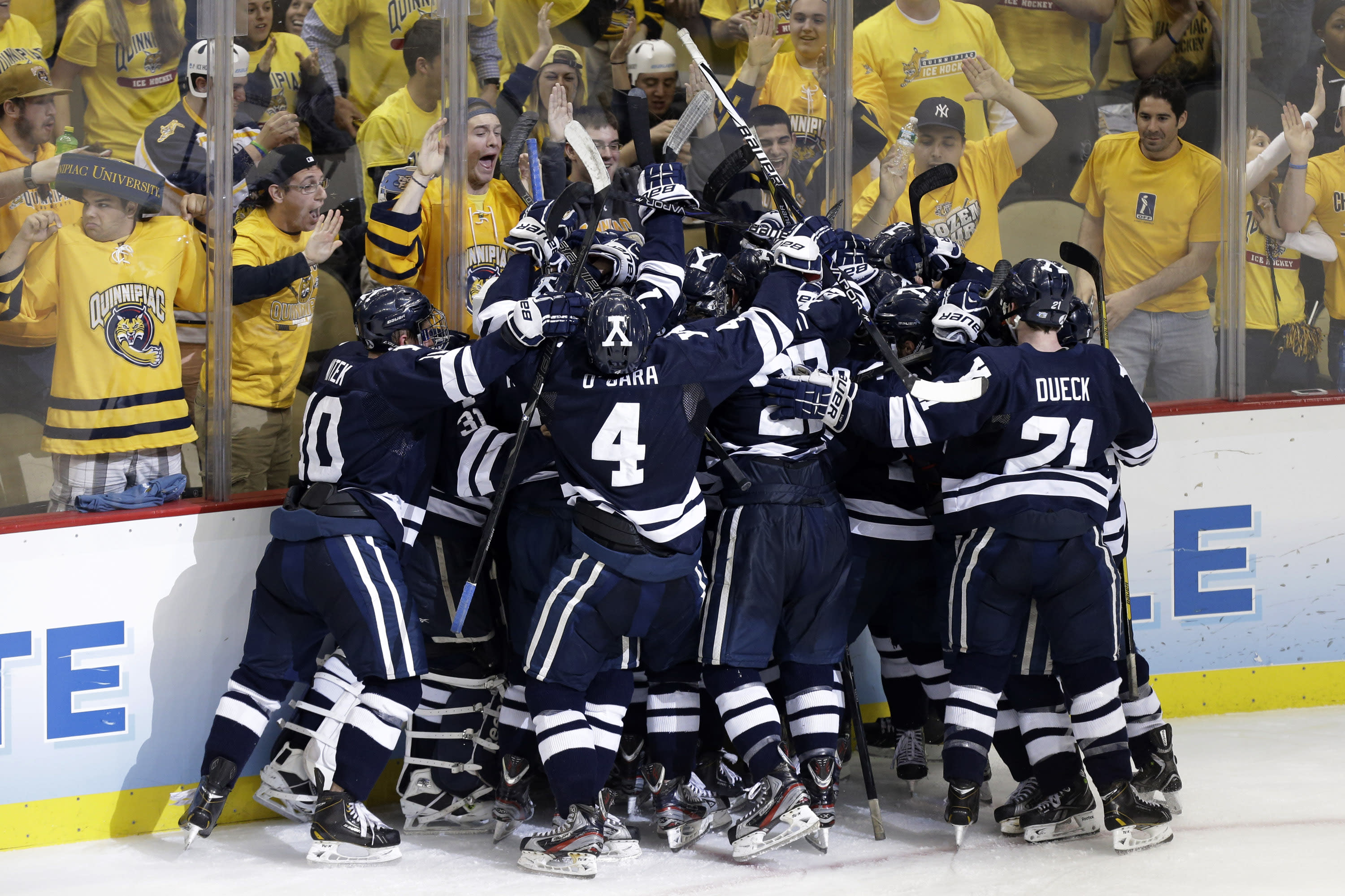 The Yale bench piles on right wing Andrew Miller to celebrate his game-winning overtime goal against UMass Lowell during an NCAA Frozen Four college hockey semifinal in Pittsburgh on Thursday, April 11, 2013. Yale won 3-2. (AP Photo/Gene J. Puskar)