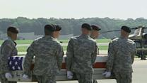 Raw: Body of U.S. General Arrives at Dover AFB
