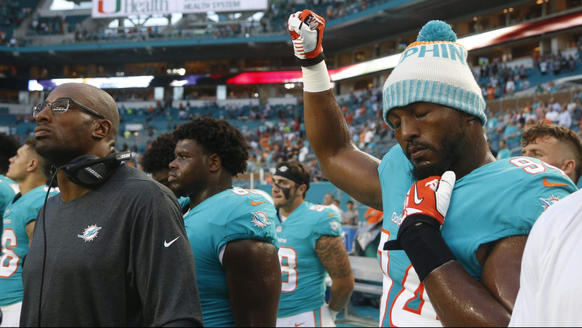 Police unions pull out of Dolphins game over anthem issue
