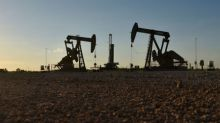 Oil near flat as market weighs U.S.-China trade tensions, Iran sanctions