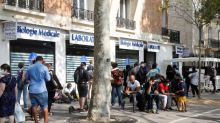French daily COVID-19 cases fall after Saturday record