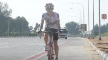 Cyclists cheer Singapore's first on-road cycling lane
