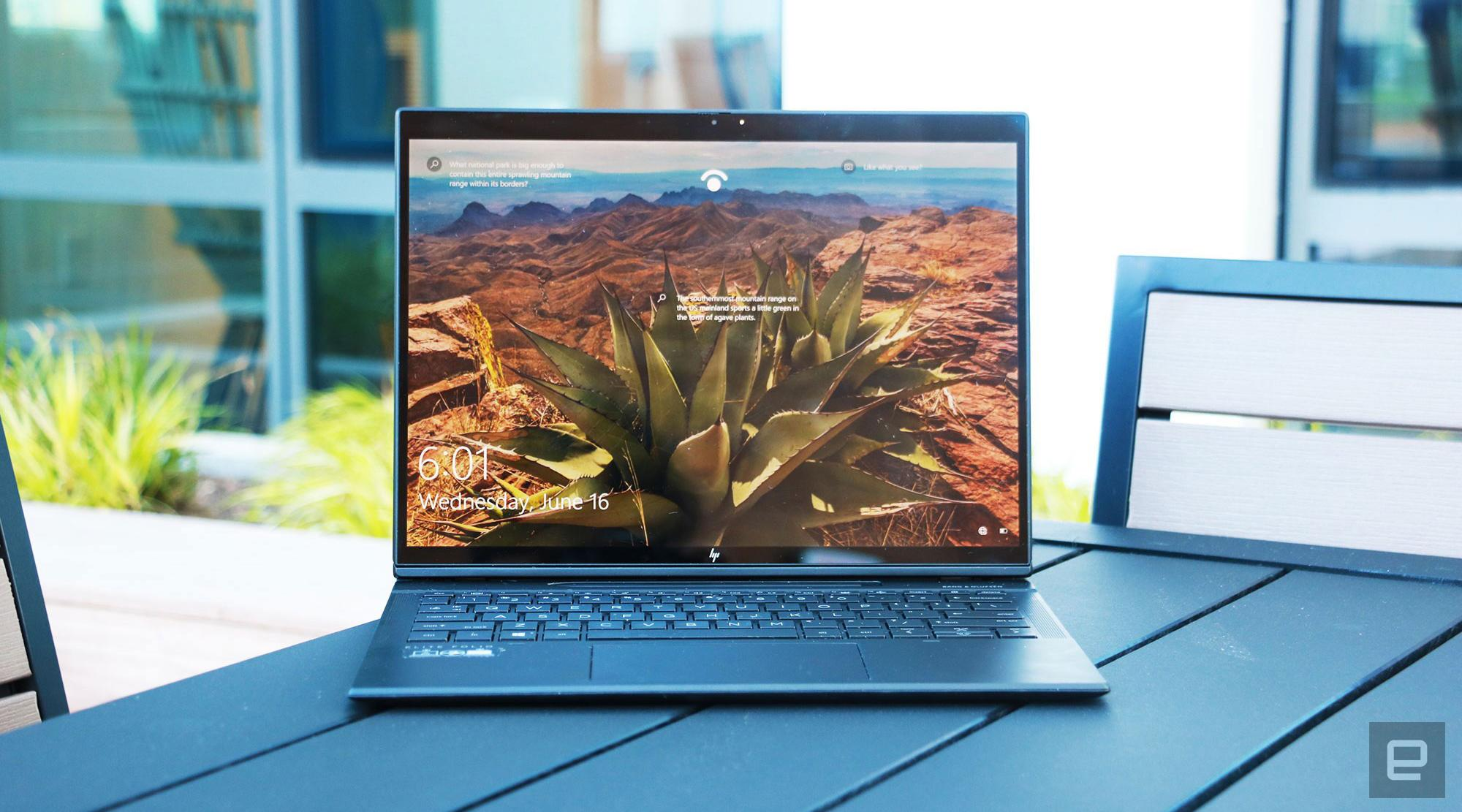 The HP Elite Folio laptop on a patio table.