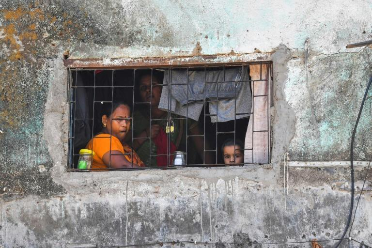 Dharavi's narrow alleys, crowded housing and poor sanitation offer the perfect breeding ground for the virus (AFP Photo/Indranil MUKHERJEE)