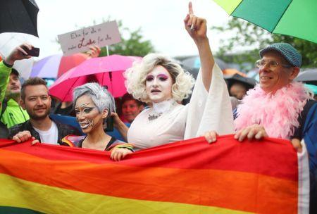 People celebrate in front of Germany's lower house of parliament Bundestag after the delegates voted on legalising same-sex marriage, in Berlin