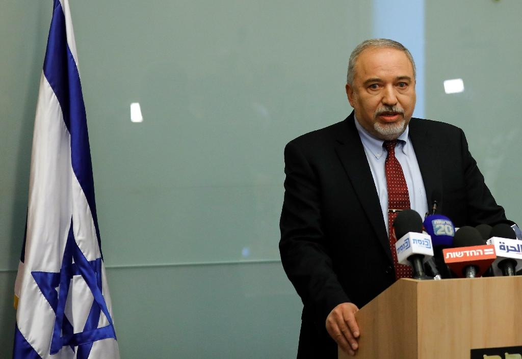 """Defence Minister Avigdor Lieberman plunges the Israeli government into turmoil by announcing he is resigning over a ceasefire deal with Palestinian militants in Gaza that he describes as """"capitulating to terror"""" (AFP Photo/Menahem KAHANA)"""