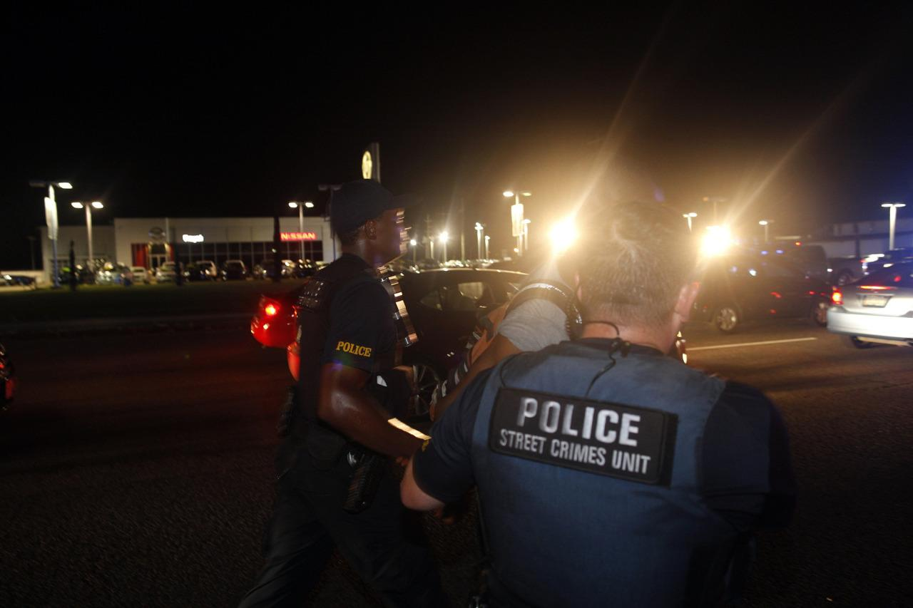 <p>Police arrest activist DeRay McKesson during a protest along Airline Highway, a major road that passes in front of the Baton Rouge Police Department headquarters Saturday, July 9, 2016, in Baton Rouge, La. Protesters angry over the fatal shooting of Alton Sterling by two white Baton Rouge police officers rallied Saturday at the convenience store where he was shot, in front of the city's police department and at the state Capitol for another day of demonstrations. (AP Photo/Max Becherer) </p>