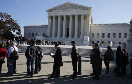 People wait in line to enter the U.S. Supreme Court in Washington