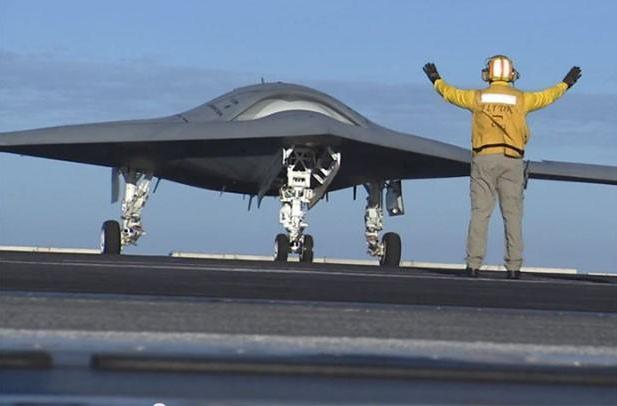 US Navy's X-47B unmanned jet successfully lands on an aircraft carrier