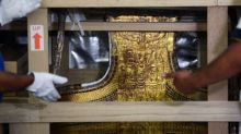 King Tut's bed, chariot paraded through Cairo to new home