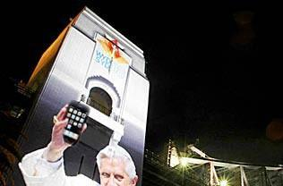 Pope Benedict XVI texting out messages of encouragement