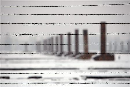 Chimneys are seen through barbed wires during a visit by French secondary school students at the Auschwitz-Birkenau death camp in Oswiecim