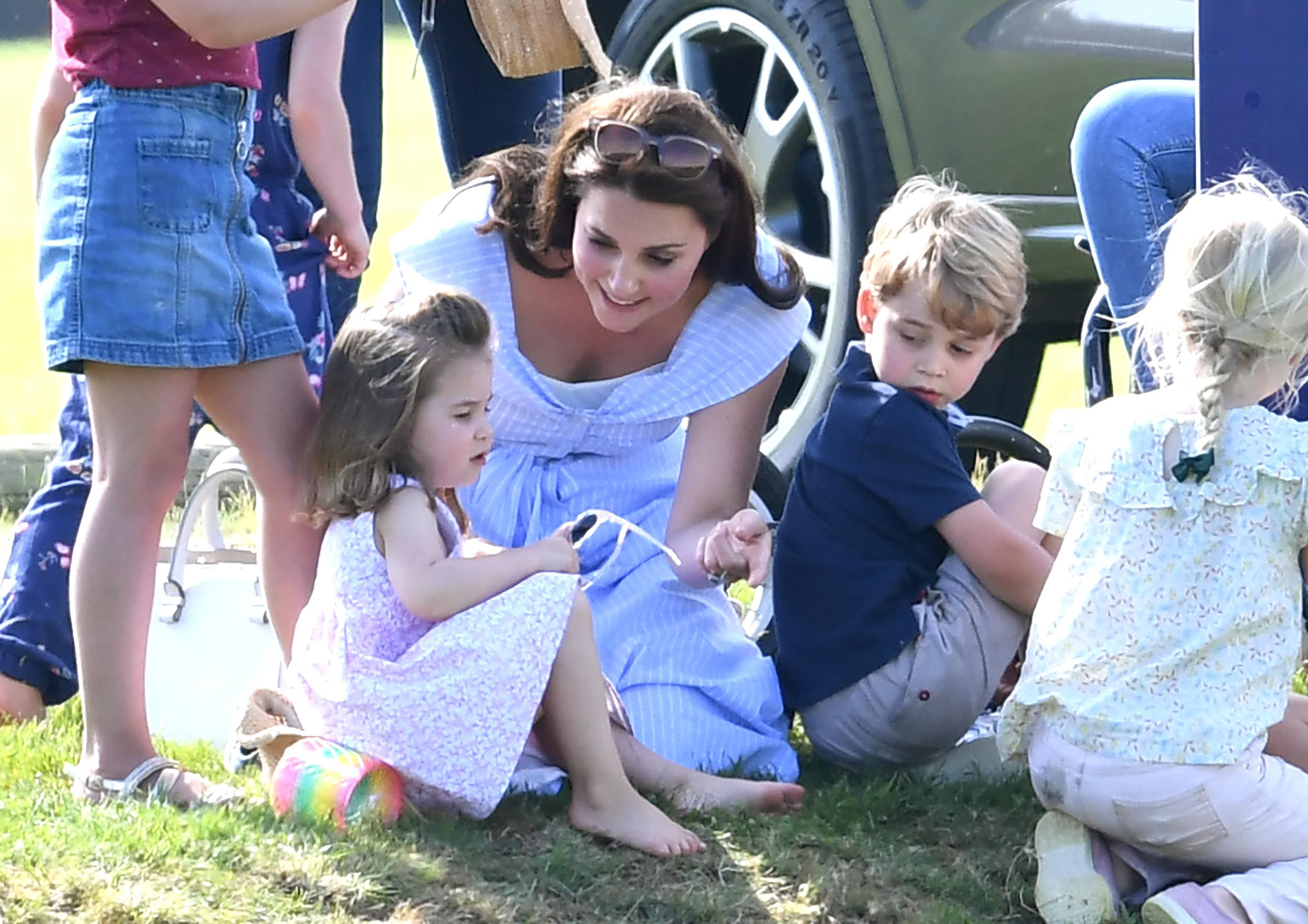 Catherine Duchess of Cambridge and Princess Charlotte watch on as Prince William Duke of Cambridge plays Polo at the Gloucestershire Festival of Polo, the Beaufort Club, . Photo credit should read: Doug Peters/EMPICS