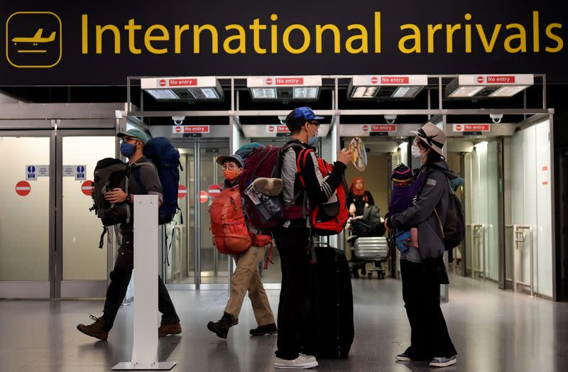 FILE PHOTO: Passengers arrive at the Gatwick Airport, in Gatwick