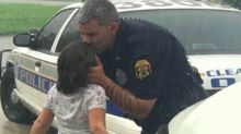 Sweet photo of police officer kissing daughter goodbye before battling Hurricane Irma goes viral