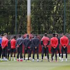 Manchester United players and staff hold minute's silence in tribute to victims of terror attack