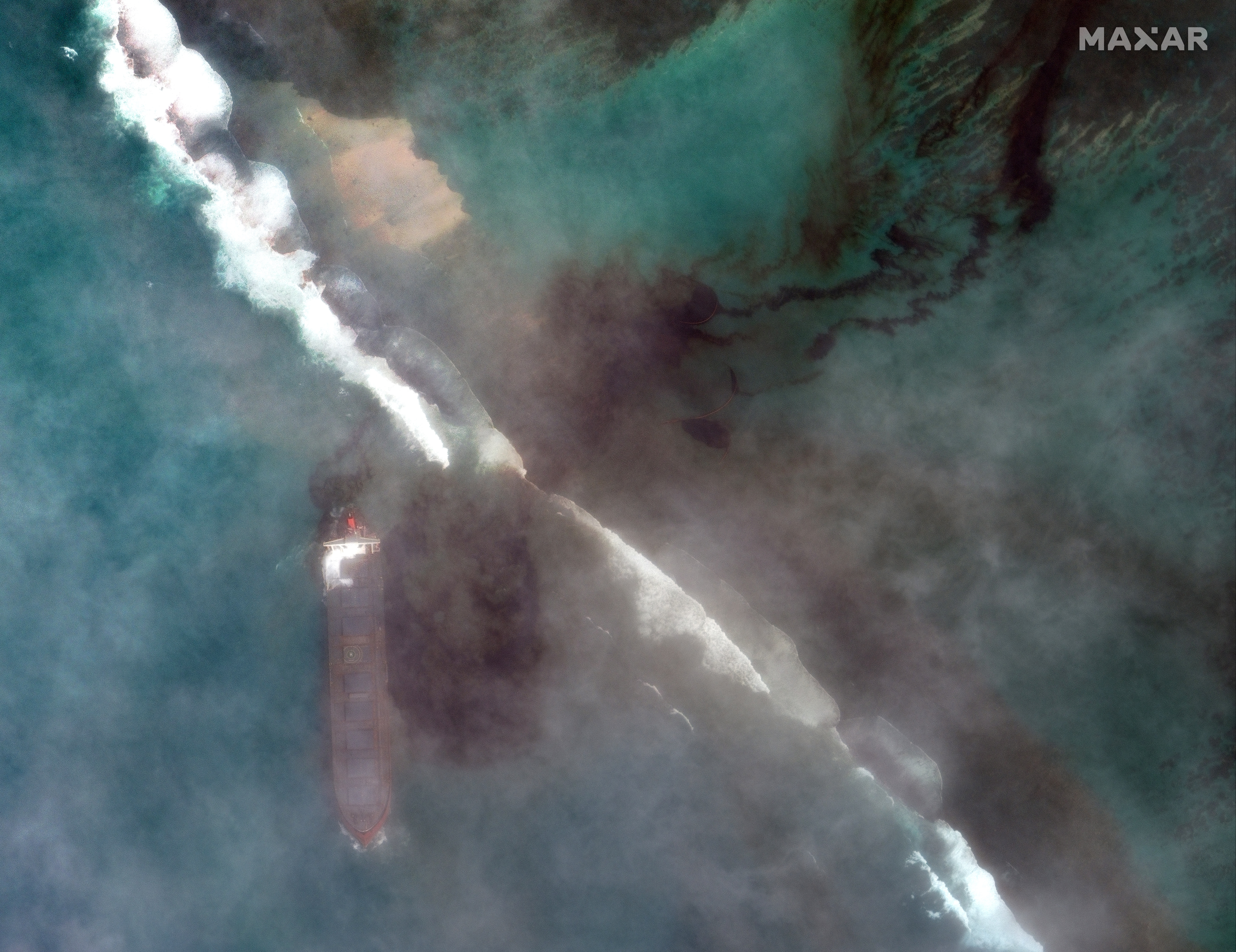 In this satellite image provided by 2020 Maxar Technologies on Friday Aug. 7 2020 an aerial view of oil leaking from the MV Wakashio a bulk carrier ship that recently ran aground off the southeast coast of Mauritius. The prime minister of Mauritius